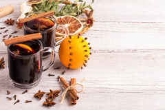 Mulled wine. Christmas mulled wine on white wooden table royalty free stock images