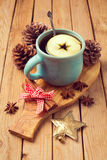 Mulled wine for Christmas on wooden table Royalty Free Stock Image