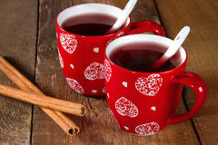 Mulled wine with cinnamon. On rustic wooden background Stock Images