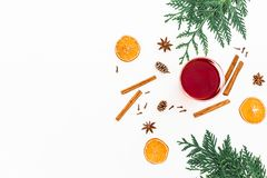 Mulled wine with cinnamon, anise, citrus and candy cane on white background. Flat lay, top view Stock Images