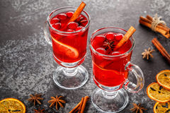 Mulled wine with cinnamon, anise, cranberries and orange. Stock Photography