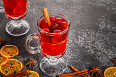 Mulled wine with cinnamon, anise, cranberries and orange. Stock Photos