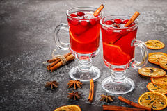 Mulled wine with cinnamon, anise, cranberries and orange. Stock Images