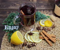 Mulled wine with a cinnamon, an anisetree, a juniper  and an inscription  enjoy Stock Photography