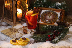 Mulled wine with cinnamon and an orange Royalty Free Stock Image