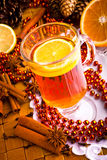 Mulled wine with cinnamon sticks Royalty Free Stock Photography