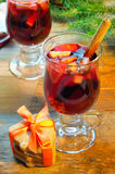 Mulled wine with cinnamon sticks and christmas bell-formed cookies Royalty Free Stock Photography