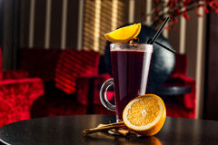 Mulled wine with cinnamon sticks in glass and christmas cookies Royalty Free Stock Photo