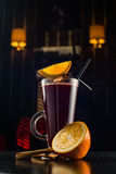 Mulled wine with cinnamon sticks in glass and christmas cookies Stock Photo