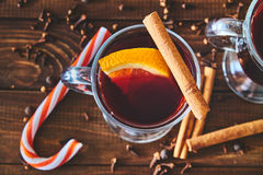 Mulled wine with cinnamon sticks and orange Royalty Free Stock Photography