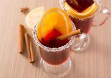 Mulled wine in clear glass mug Stock Images
