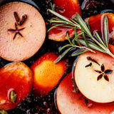 Mulled wine close up. Mulled wine hot drink with citrus, apple and spices close up Royalty Free Stock Photos