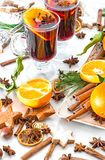 Mulled wine cocktail orange fruits spices Christmas decoration. Mulled wine cocktail with orange fruits and spices. Christmas table decoration stock photography
