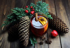 Mulled wine with cones, a lemon, a juniper, cinnamon, an anisetree and apple Stock Image