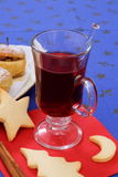 Mulled wine with cookies and baked apple Stock Photo