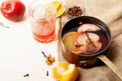 Mulled wine in copper saucepan stock photography