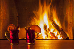 Mulled wine at cozy fireplace firelight only Royalty Free Stock Photo