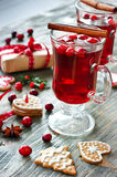 Mulled wine with cranberry, cookies and christmas decorations royalty free stock photo