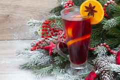 Mulled wine with decorated christmas tree Stock Image