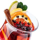 Mulled wine. Decorated with cinnamon sticks, star anise, cloves and juniper with berries Stock Photos