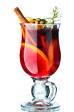 Mulled wine. Decorated with cinnamon sticks, star anise, cloves and juniper with berries royalty free stock photos