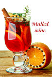 Mulled wine. Decorated with cinnamon sticks, star anise, cloves and juniper with berries on wooden table Stock Images