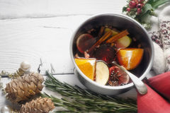 Mulled wine with different spices  and fruits in the pot horizontal Stock Image