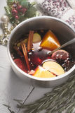 Mulled wine with different spices  and fruits in the pot top view Stock Photography