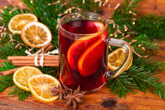 Mulled wine festive decorated on old wooden background Royalty Free Stock Photos