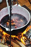 Mulled wine on fire. Mulled wine with lemon and spices on fire Stock Image