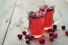 Mulled wine with fresh cranberry. And anise on wooden background Royalty Free Stock Photography