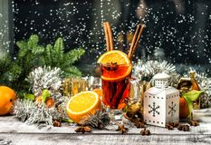 Mulled wine fruit spices Window decoration christmas ornaments. Mulled wine with fruit ans spices. Window decoration christmas tree and ornaments Royalty Free Stock Images