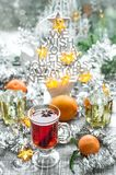 Mulled wine Christmas ornaments window decoration. Mulled wine with fruits ans spices. Christmas ornaments window decoration Stock Photo