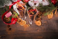 Mulled wine with fruits, cinnamon sticks, anise and decorations Stock Photography