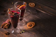 Mulled wine with fruits, cinnamon sticks, anise and decorations Stock Image