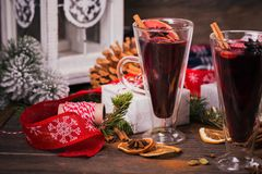 Mulled wine with fruits, cinnamon sticks, anise and decorations Royalty Free Stock Photos