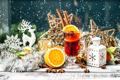 Mulled wine fruits spices cocktail drink Christmas decoration. Mulled wine with fruits and spices. Christmas window decoration. Winter cocktail drink royalty free stock photography