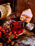 Mulled wine with ginger snap and bottle. Menu background. Royalty Free Stock Photo