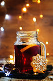 Mulled wine with gingerbread cookies and Christmas light Stock Photography