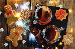 Mulled wine with gingerbread cookies and Christmas light Stock Images