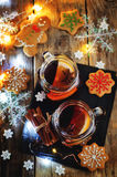 Mulled wine with gingerbread cookies and Christmas light Royalty Free Stock Photography