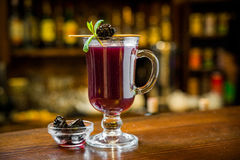 Mulled wine with in the glass. Mulled wine with wine in the glass on the bar royalty free stock image