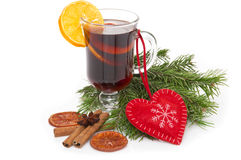 Mulled wine in glass with cinnamon stick, christmas tree and heart isolated on a white Royalty Free Stock Images