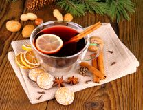 Mulled wine in glass with cinnamon stick, gingerbread and nuts Royalty Free Stock Photography