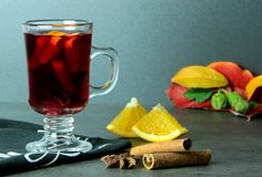 Mulled wine with spices and citrus fruits. Royalty Free Stock Photo