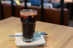 Mulled wine in glass cup stands on table on background summer cafe Royalty Free Stock Photo