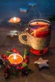 Mulled wine in a glass cup on a wooden table with Christmas deco Royalty Free Stock Photos