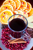 Mulled wine. A glass of mulled wine with fruit and cinnamon royalty free stock photos