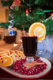 Mulled wine. A glass of mulled wine with fruit and cinnamon stock image