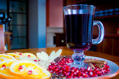 Mulled wine. A glass of mulled wine with fruit and nuts royalty free stock photo